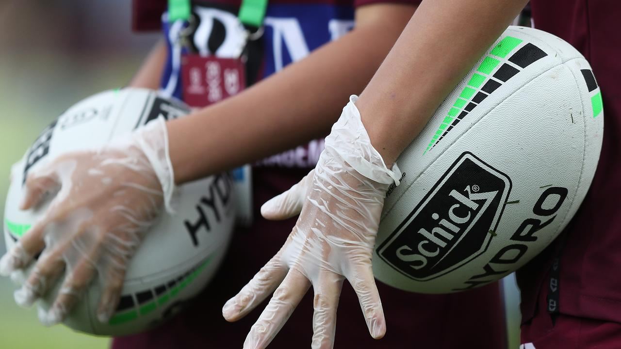 Ball boys wore gloves at Lottoland. Picture: Brett Costello