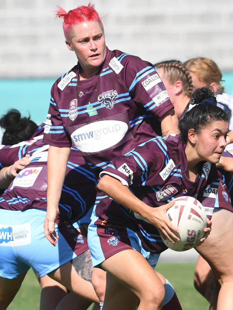 BAKERS' DELIGHT: CQ Capras' Keysha Baker with the ball as Chelsea Baker watches on in a trial game. On Sunday, Chelsea scored the Capras first-ever try in a premiership match.