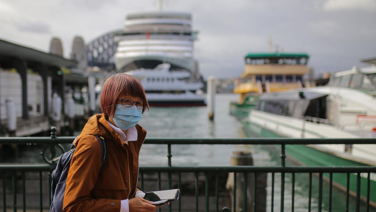 A woman wearing a face mask as a preventative measure against coronavirus COVID-19 walks through Circular Quay in Sydney. Picture: AAP/Steven Saphore