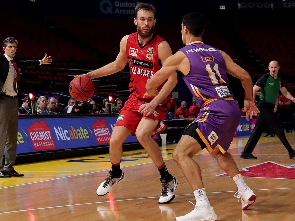 Nick Kay looks to pass the ball during game three of the NBL grand final series.