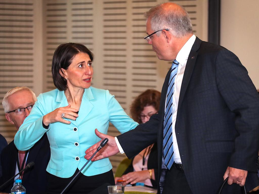NSW Premier Gladys Berejiklian appeared to pull her hand away when Australian Prime Minister Scott Morrison went to shake it earlier this week. Picture: AAP Image/David Gray