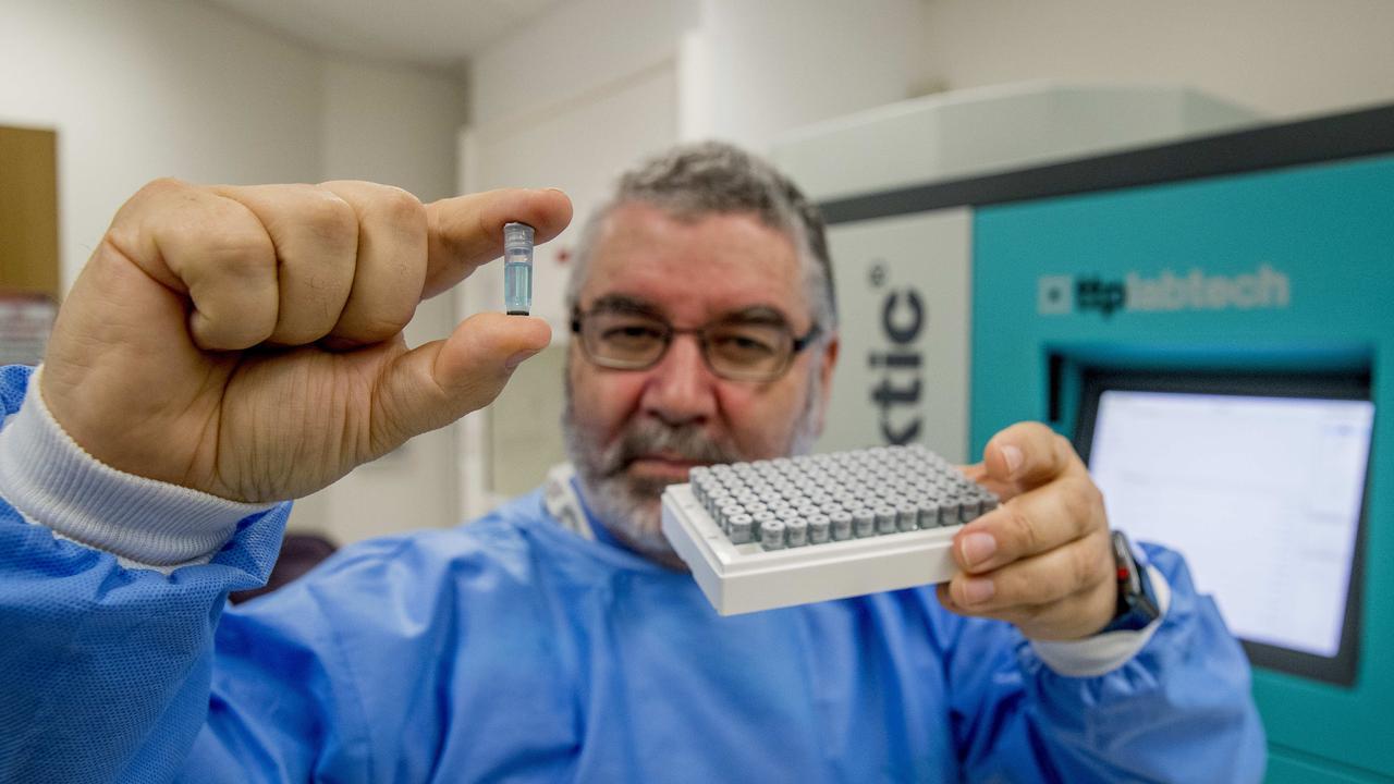 Professor Nigel McMillan holding samples. Picture: Jerad Williams