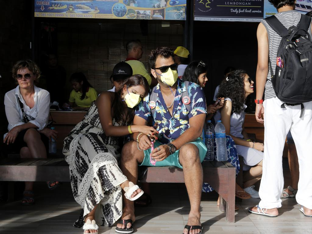 Bali tourists wait for their departure at a harbour as tourism on the resort island has fallen due to the coronavirus outbreak. Picture: AP