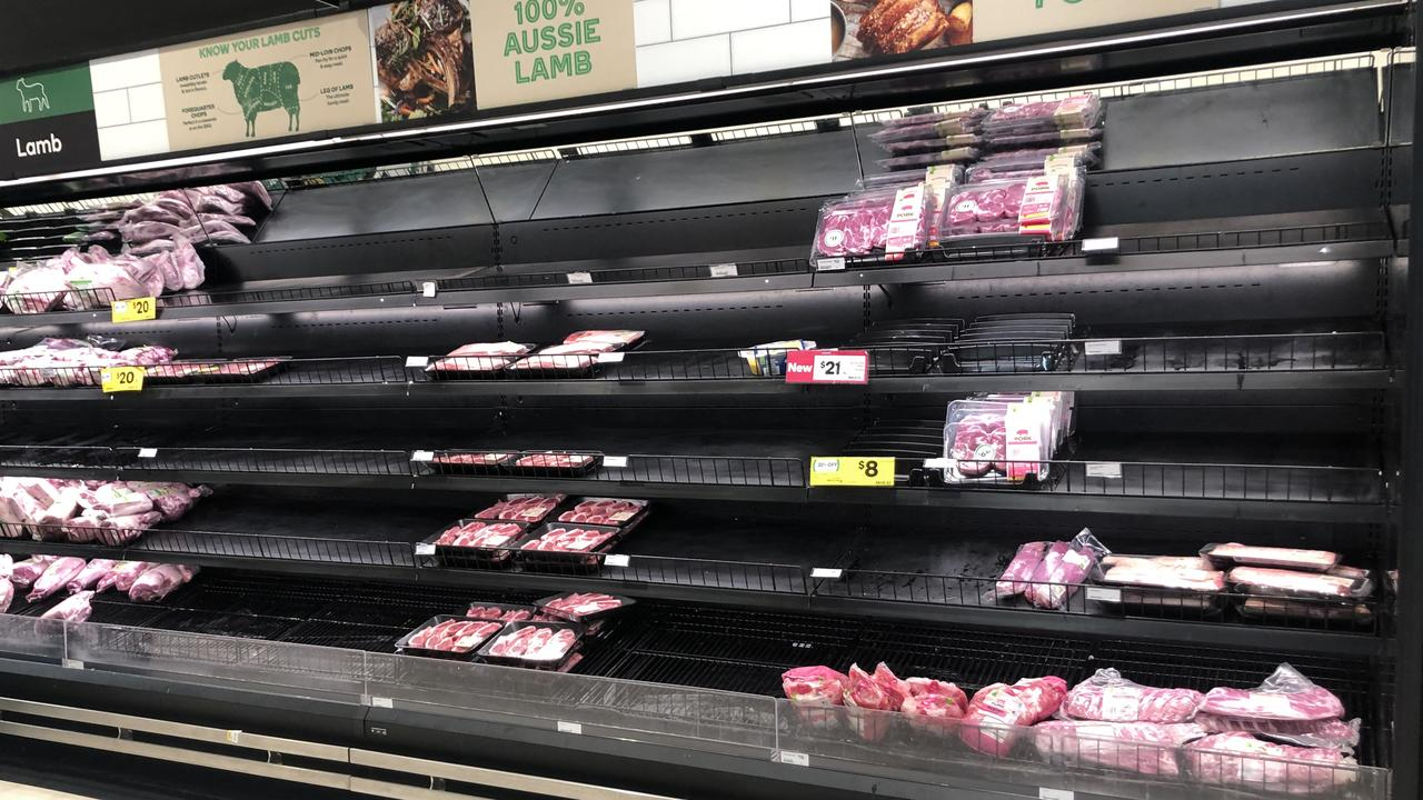 Certain cuts of lamb selling out as Darwinites panic buy at night-life Woolworths. Picture Glenn Campbell