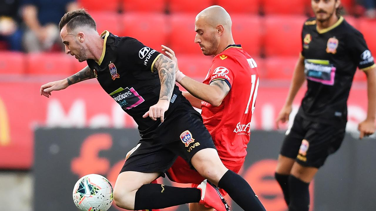 Roy O'Donovan is tackled by James Troisi in United's 0-3 loss to the Jets. Picture: Mark Brake/Getty Images.