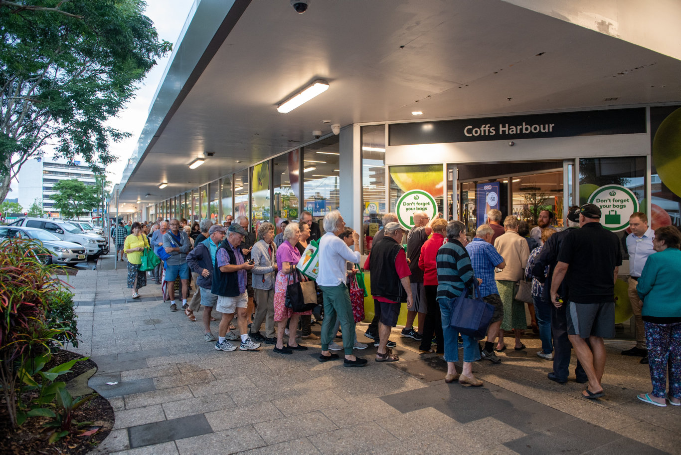 Pension card holders queue up outside Woolworths Coffs Harbour early this morning.