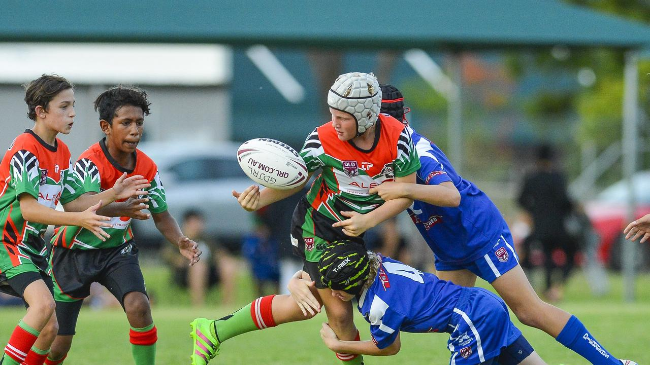 Ty Fitzgerald from tannum Rugby League Club is crunched in a tackle against Gladstone Valley's.