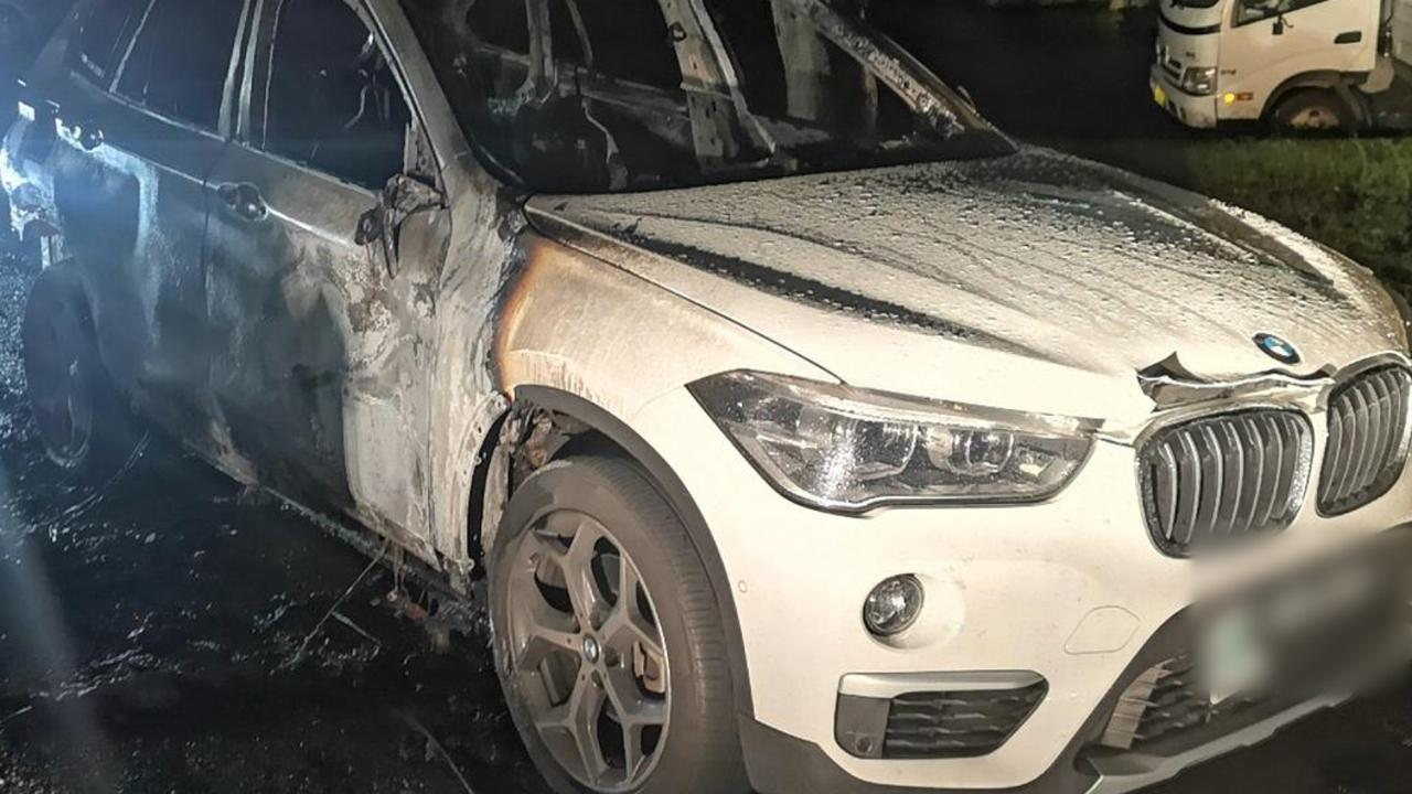 A torched BMW used in the kidnapping. Picture: NSW Police.