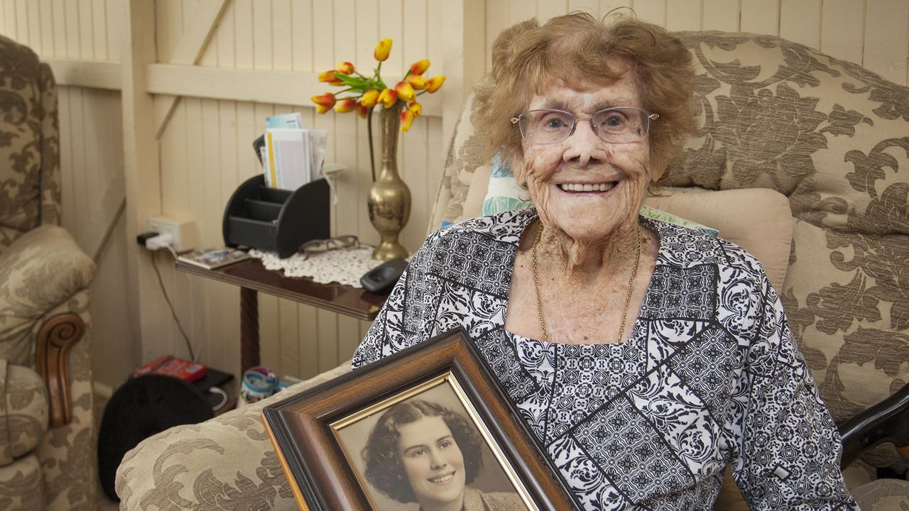 Cecilia Hynes of Maryborough, 102 years of age, holding a photograph of herself when she was aged 18 years.
