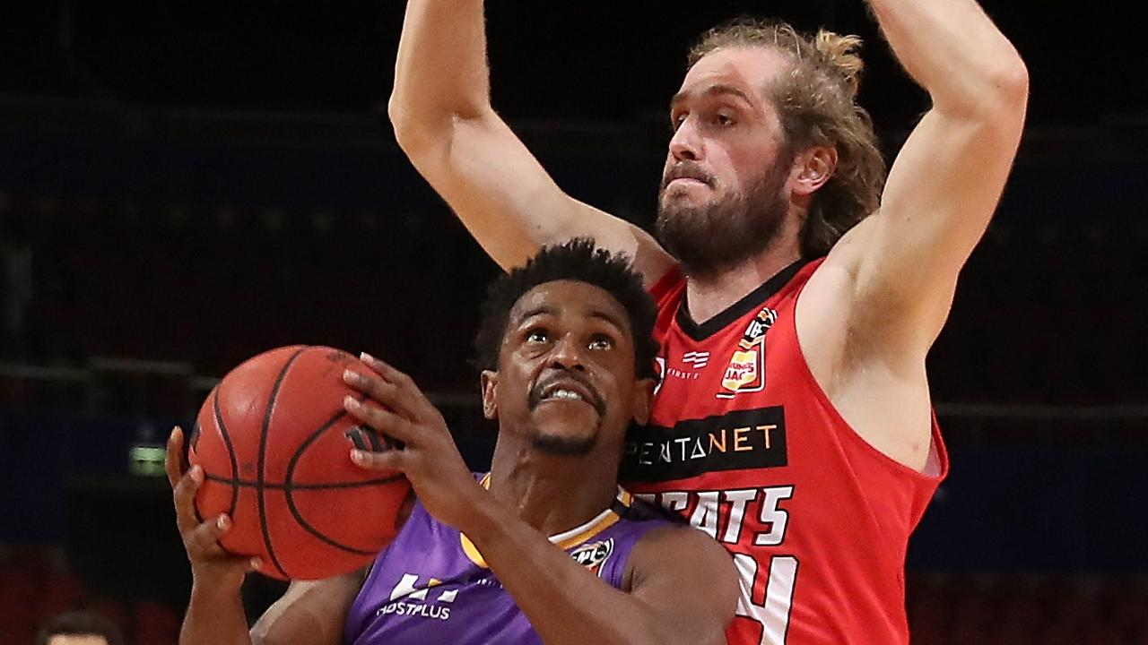 Sydney Kings stars Casper Ware drives to the basket against Jesse Wagstaff in game 3 of the NBL Finals. Picture: Getty Images