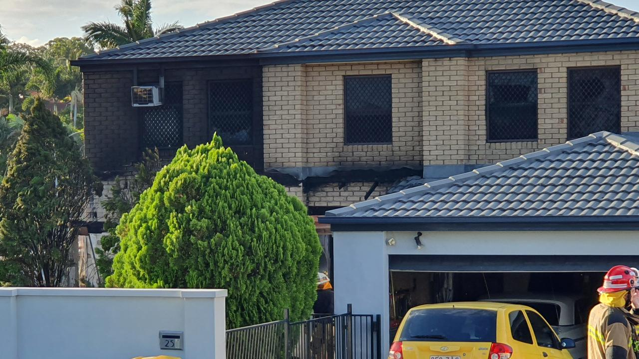 Police have established a crime scene after fire ripped through a two-storey home this afternoon, with neighbours hearing explosions.