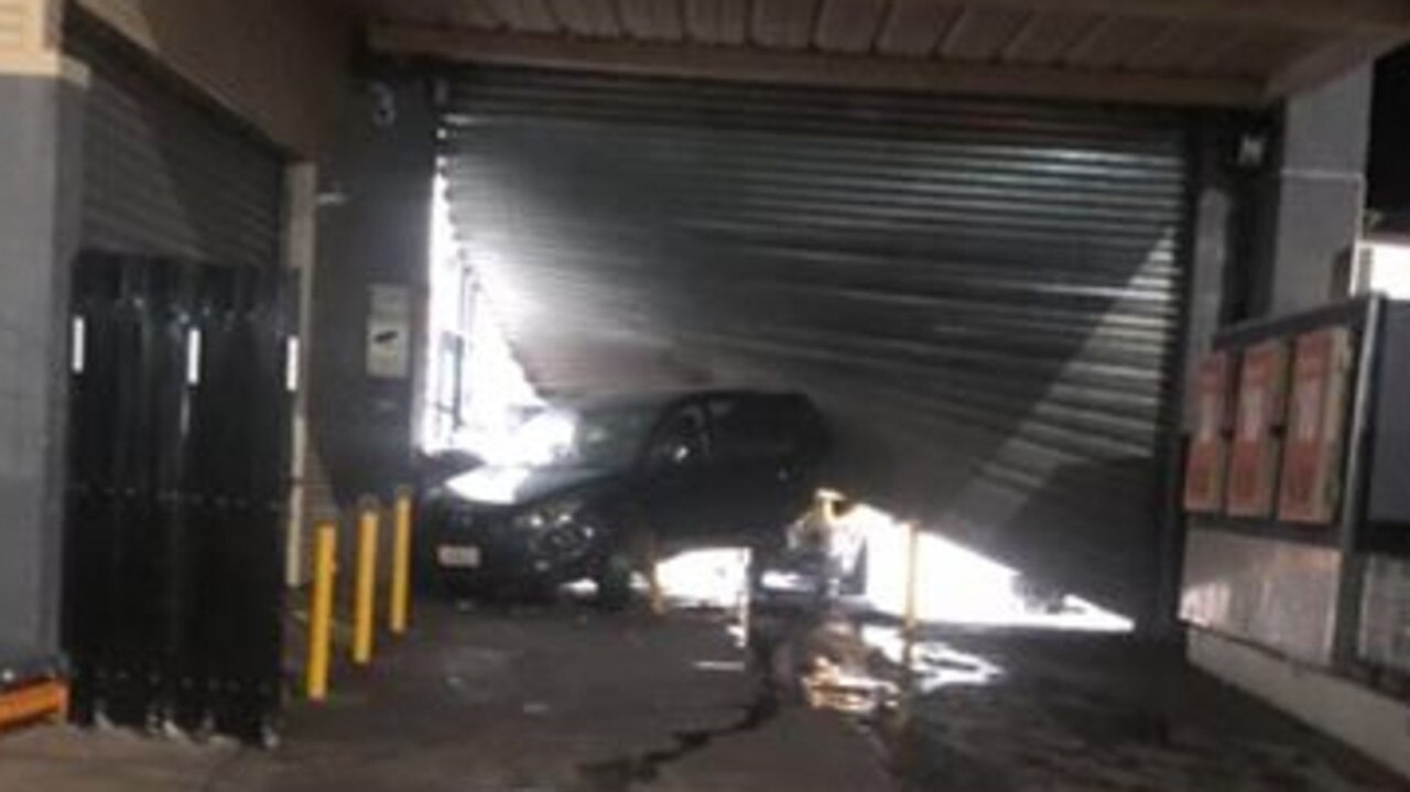 A black Mazda 3 sedan was used by youth to allegedly ram raid the BWS Palmerston drive-through overnight. Picture: Supplied
