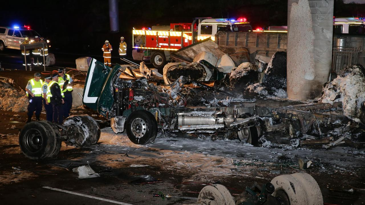 A body has been found in the wreckage of a horror truck crash on the M1 in Sydney's north. Picture: Picture: Bill Hearne