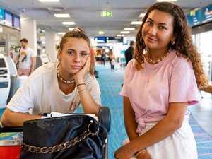 Travellers rush home amid coronavirus fears