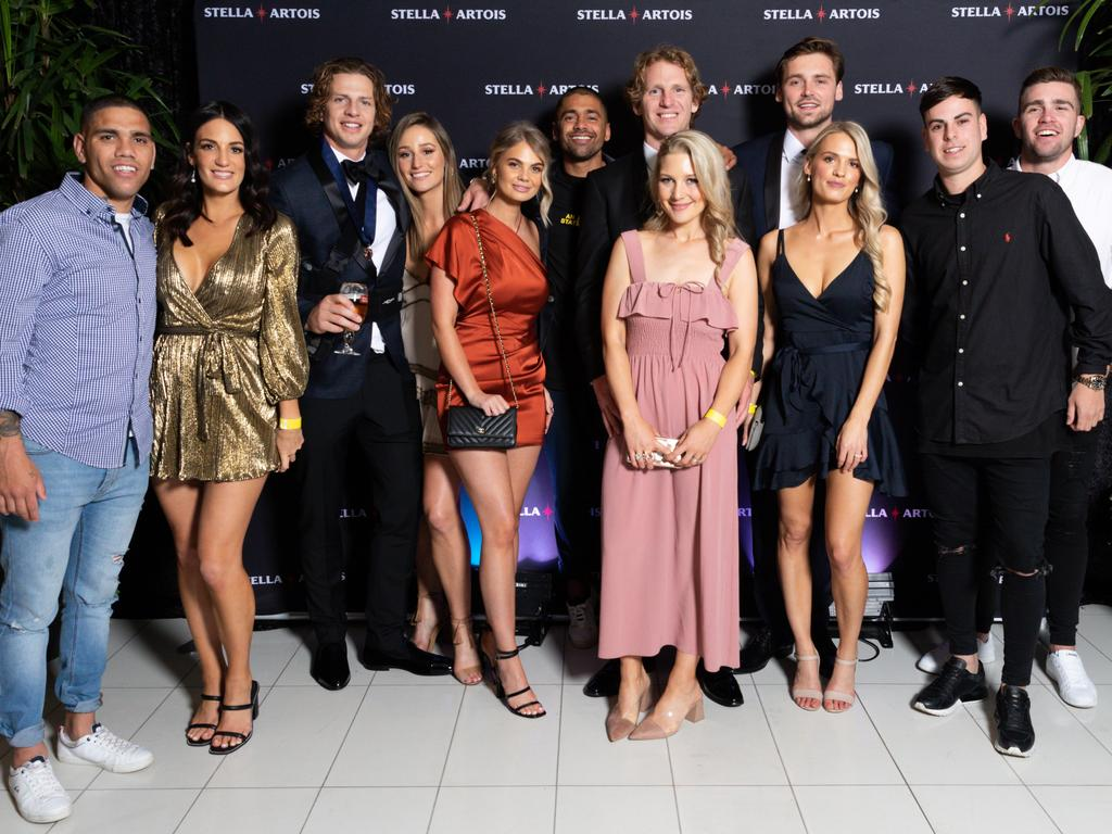 Fremantle players and partners at a Brownlow medal after party.