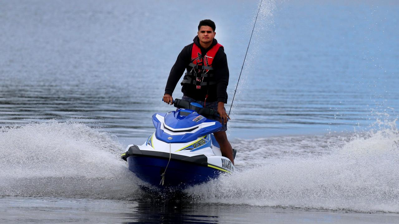 NRL player Latrell Mitchell arrives back from fishing from his jet ski on the Manning River at Taree. Pic Peter Lorimer