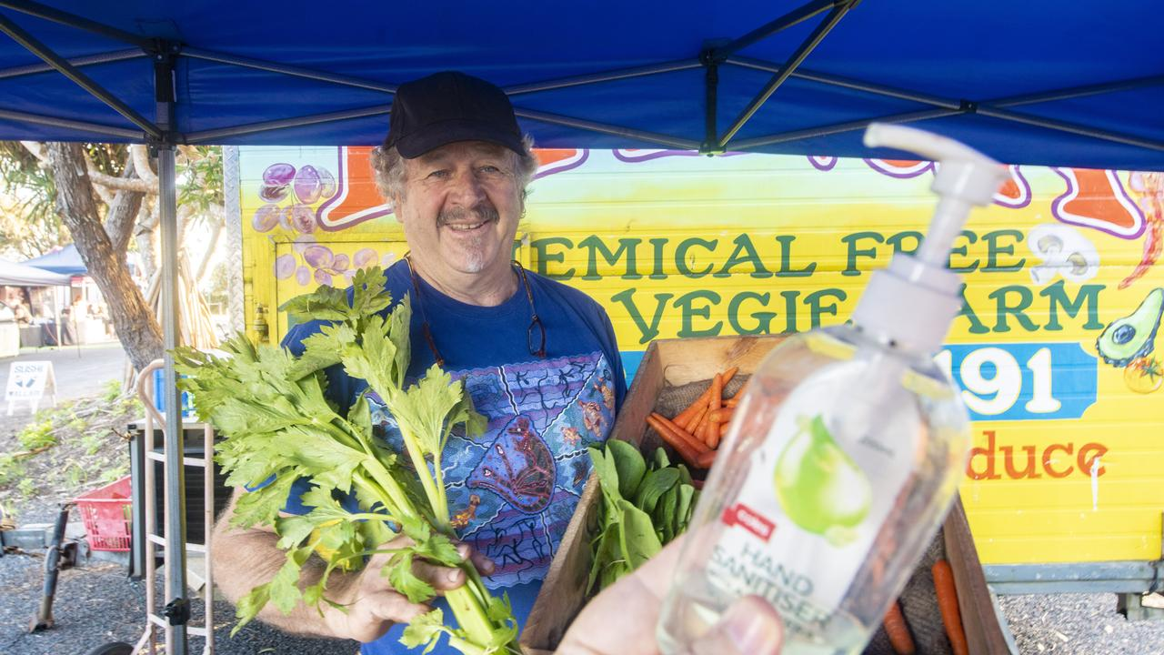 Calvin Pewser of Pillar Valley serves his vegetables at the Yamba Farmers and Growers Market.