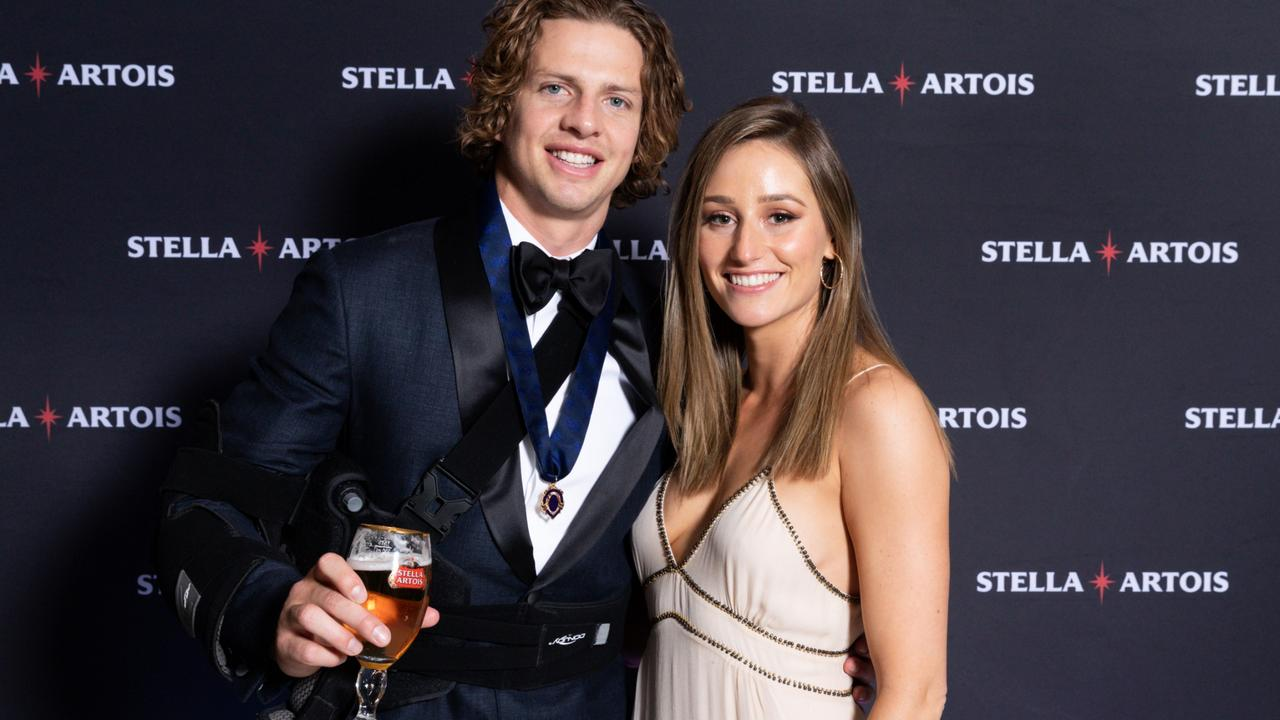 The wives and girlfriends of some AFL players have been told to stay away from their partners with some forced to say uncertain farewells.