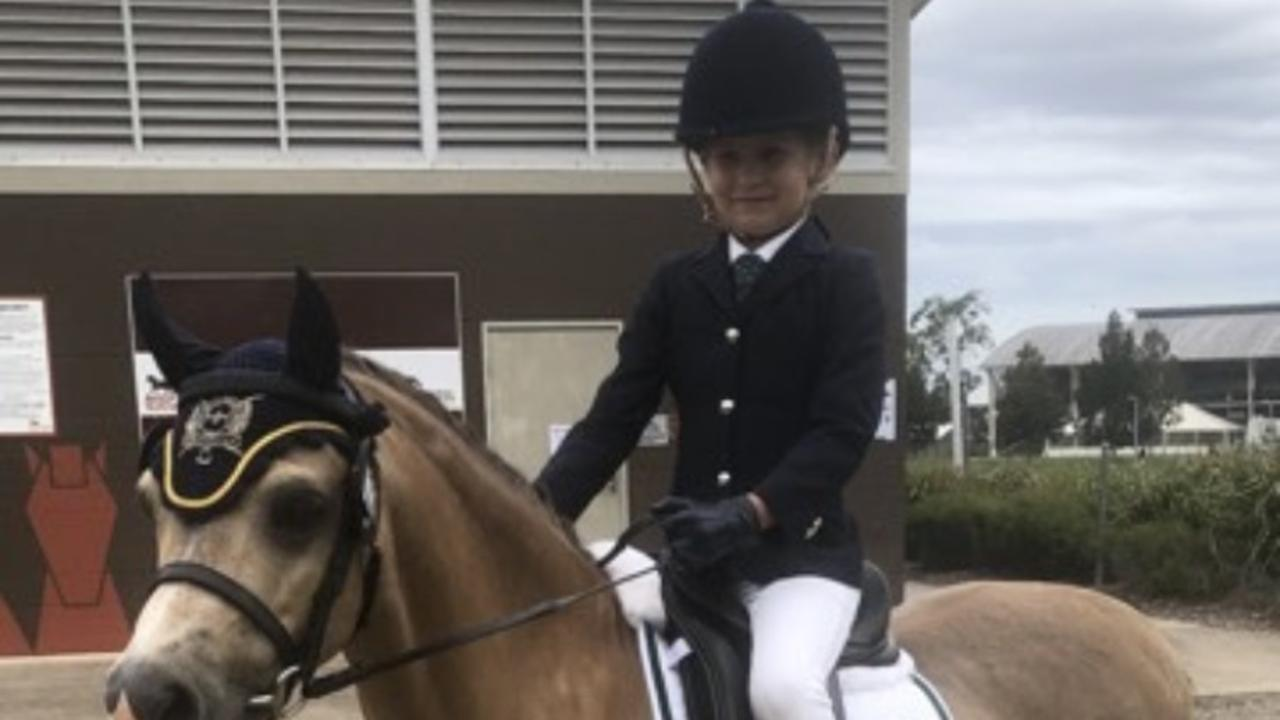 YOUNG CHAMP: Ruby Hooper with her pony Wyann Caramel Classic.