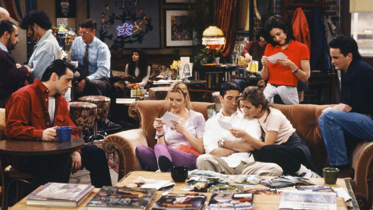 The cast at the iconic Central Perk Cafe set.