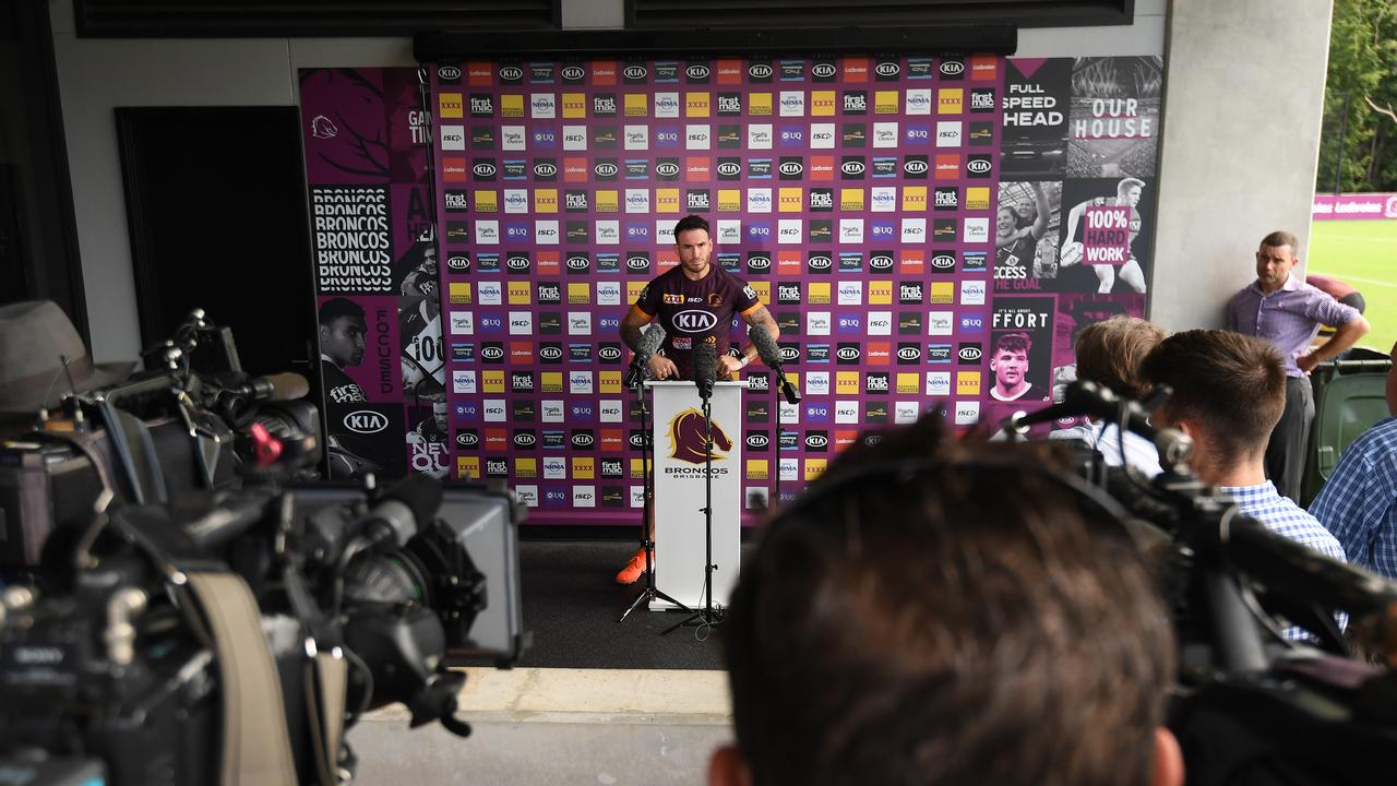 The media keeps a safe distance from Brisbane Broncos player Darius Boyd. (AAP Image/Dan Peled)
