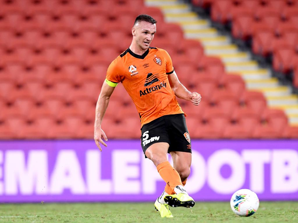 Thomas Aldred of the Roar in action at a virtually empty Suncorp Stadium last week. This will be the taste of things to come in the A-League. (Photo by Bradley Kanaris/Getty Images)