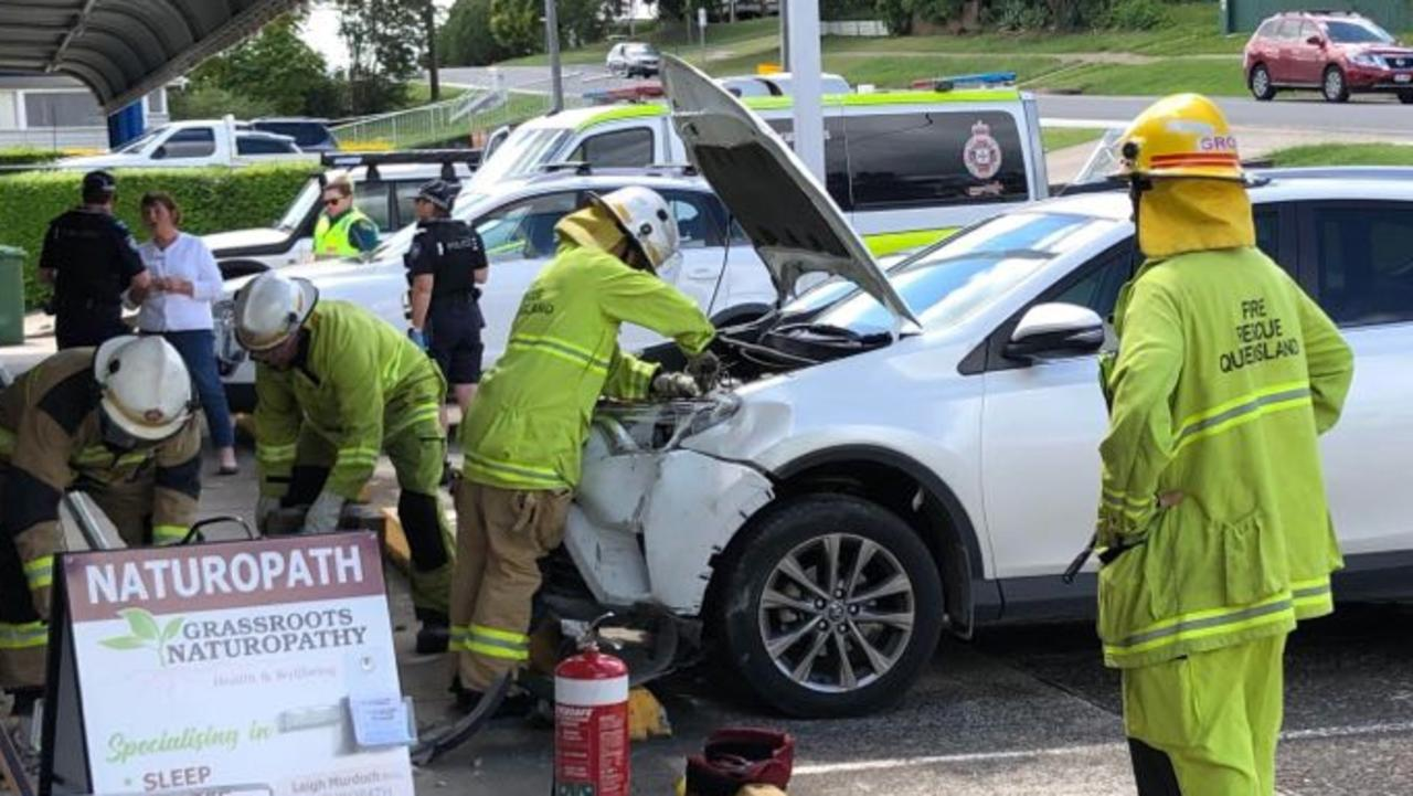 A woman escaped injury after her car crashed into the front of a Gympie shop.