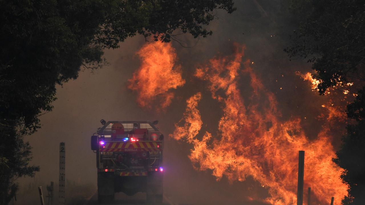 ACCESS IS KEY:Firefighters battle blazes at Nana Glen late last year. (AAP Image/Dan Peled)