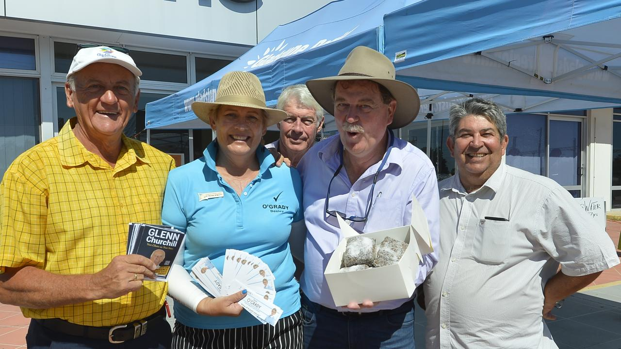 Candidates Cr Glenn Churchill, Cr Desley O'Grady, Mark McLachlan, Darryl Branthwaite and Mick McAullay with lamingtons dropped off by a local business owner as they put in long hours at the Gladstone early voting booth.