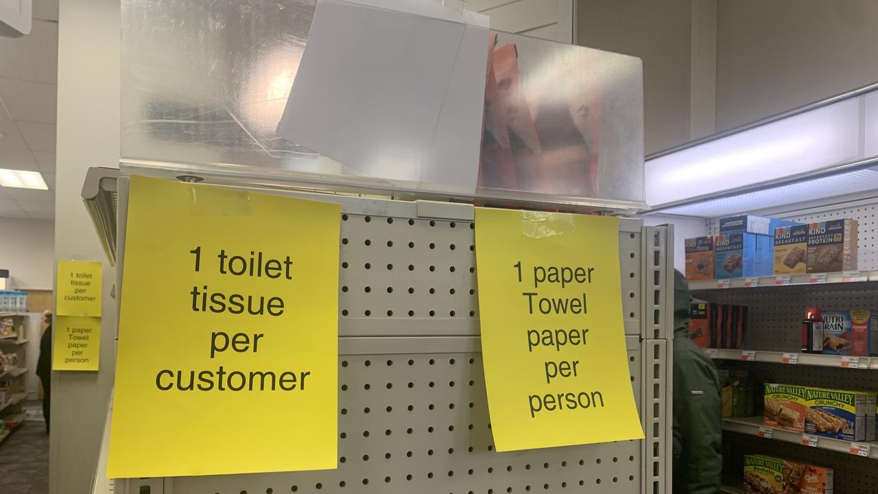 Signs inside a CVS Pharmacy.