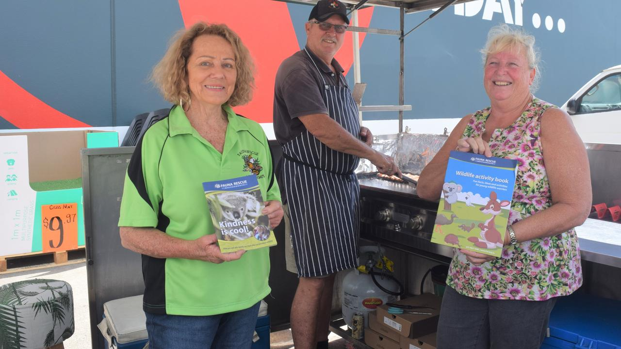 Barb McLennan, Neil Cutten and Viv Kingsland sizzling up some sausages at Bunnings to raise money for Fauna Rescue Whitsundays (file photo).