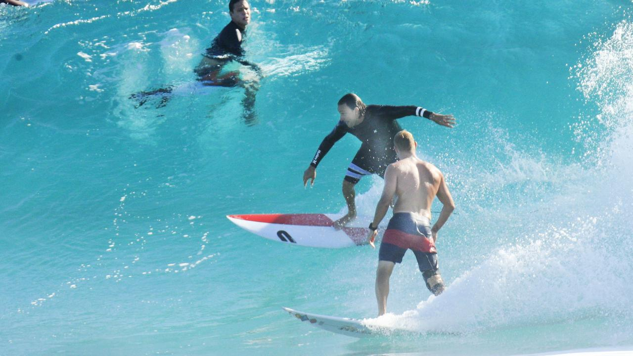 Mick Fanning (right) and the mystery surfer. Picture: Scott Powick