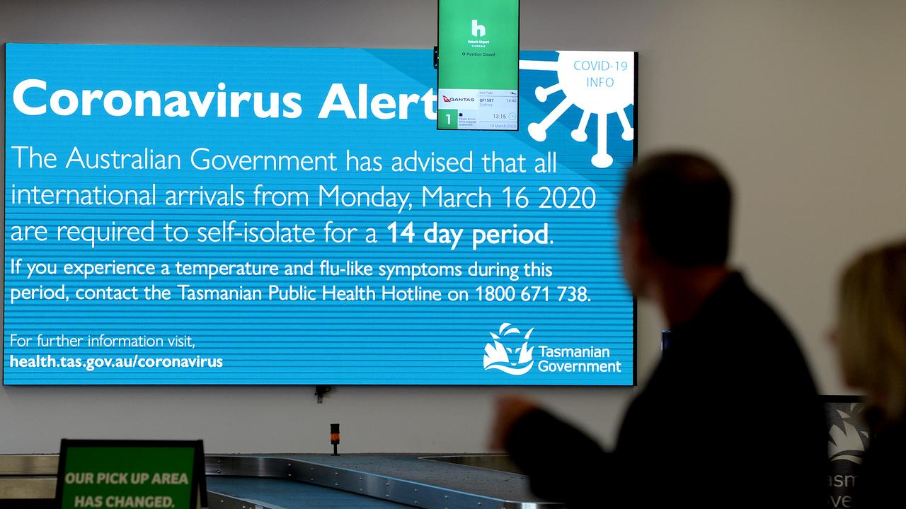 HOBART, AUSTRALIA - MARCH 19: Passengers reading information supplied at Hobart airport on March 19, 2020 in Hobart, Australia. The Tasmanian premier Peter Gutwein has announced all interstate travellers will be required to quarantine for 14 days. The measures are the toughest to be imposed in Australia, and will come into effect from Friday 20 March. There are now 596 confirmed cases of COVID-19