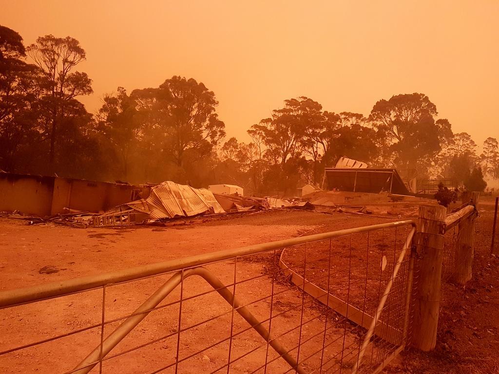 The red haze envelopes Malua Bay during the bushfires.
