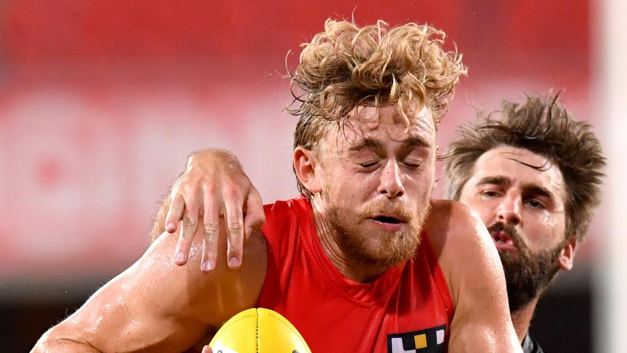 Hugh Greenwood (left) of the Suns is tackled by Justin Westhoff (right) of the Power during the Round 1 AFL match between the Gold Coast Suns and Port Adelaide Power at Metricon Stadium on the Gold Coast, Saturday, March 21, 2020. (AAP Image/Darren England) NO ARCHIVING, EDITORIAL USE ONLY