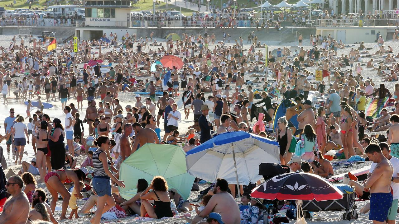 People folk to Bondi Beach despite the threat of the coronavirus on Friday. Picture: John Fotiadis/AAP