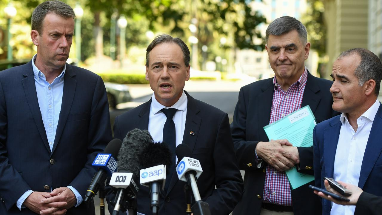 Minister for Education Dan Tehan with Minister for Health Greg Hunt, Chief Medical Officer Brendan Murphy and Victorian Deputy Premier James Merlino. Picture: AAP /Erik Anderson
