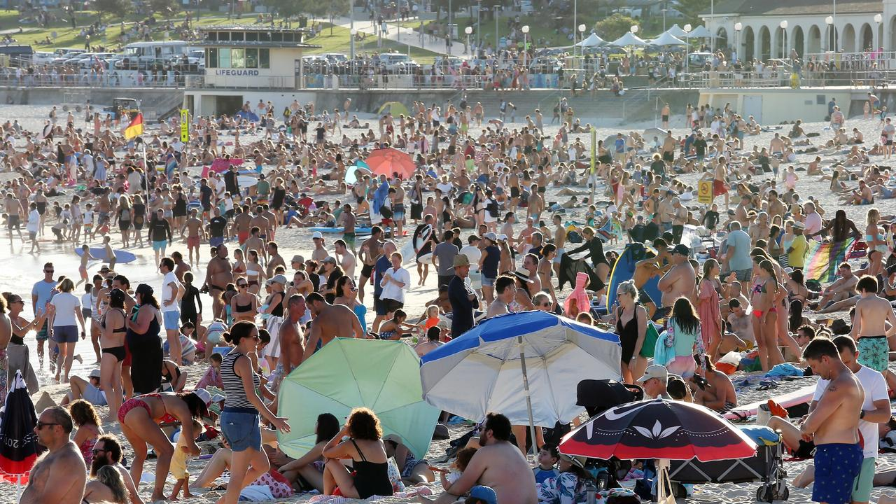 Large crowds have been spotted at beaches and pubs, despite strict advice from the government to stay away.