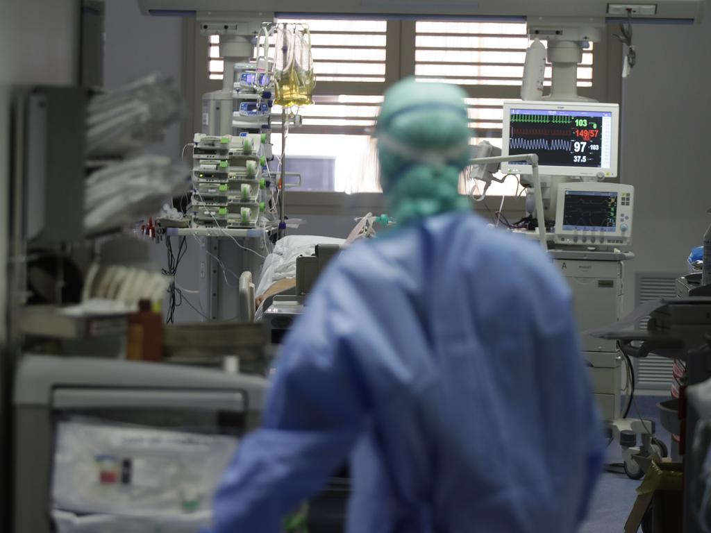 A doctor watches a coronavirus patient under treatment in the intensive care unit of the Brescia Hospital in Italy. Italian hospitals are struggling to make room for the onslaught of coronavirus patients. Picture: AP