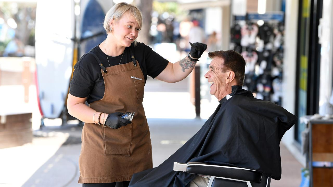 Linny Taylor of Castaway Barber with long-time customer Arthur George. Photo: Patrick Woods / Sunshine Coast Daily.