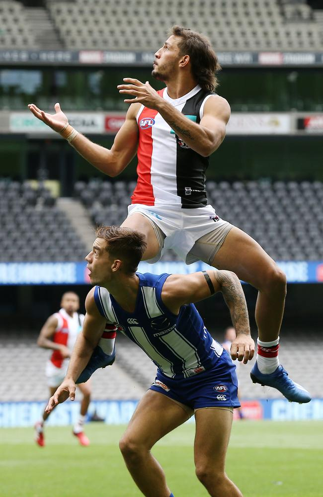 Ben Long flies to mark over Jy Simpkin of the Kangaroos. Picture: Michael Klein