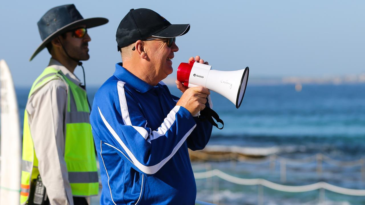Rangers and Lifeguards informing the public to leave or they would receive a $350 fine on Bondi. Picture: Gaye Gerard/Daily Telegraph