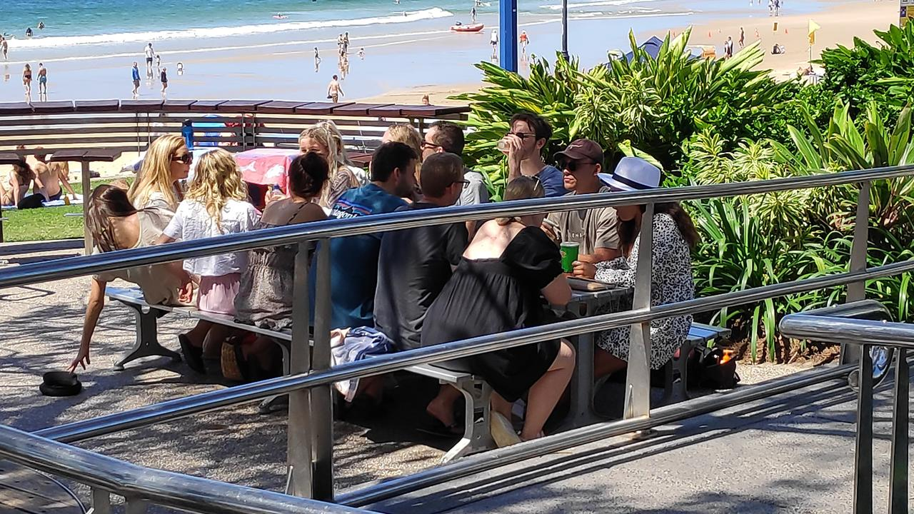 TOO CLOSE: A group of young people socialise at Mooloolaba on Sunday. Photo: Supplied