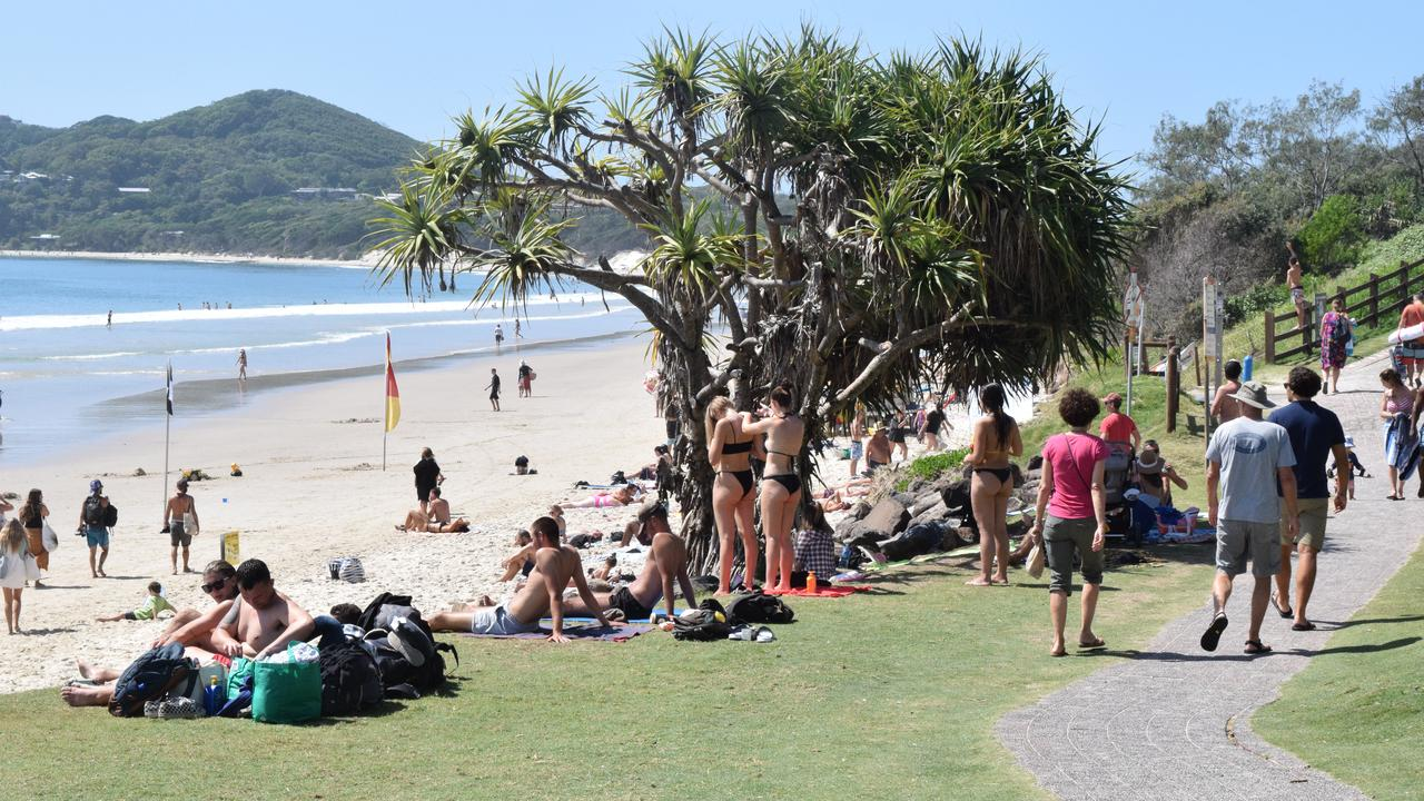 Hundreds still enjoy Byron's sun and sand despite social distancing rules.