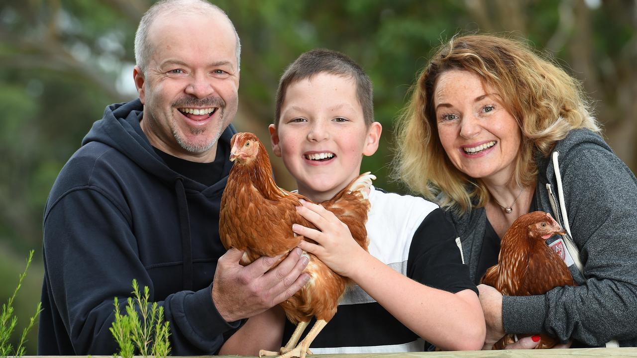 Darren, Benjamin and Rebecca Walker with their new chickens from Talking Hens in Merricks. Picture: Josie Hayden