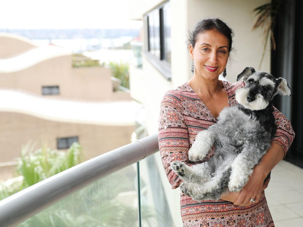 Angus the pooch, the designer tower and the $100,000 court case. Angus and his owner, Jo Cooper, at the Horizon Building in Darlinghurst. Picture: Rohan Kelly