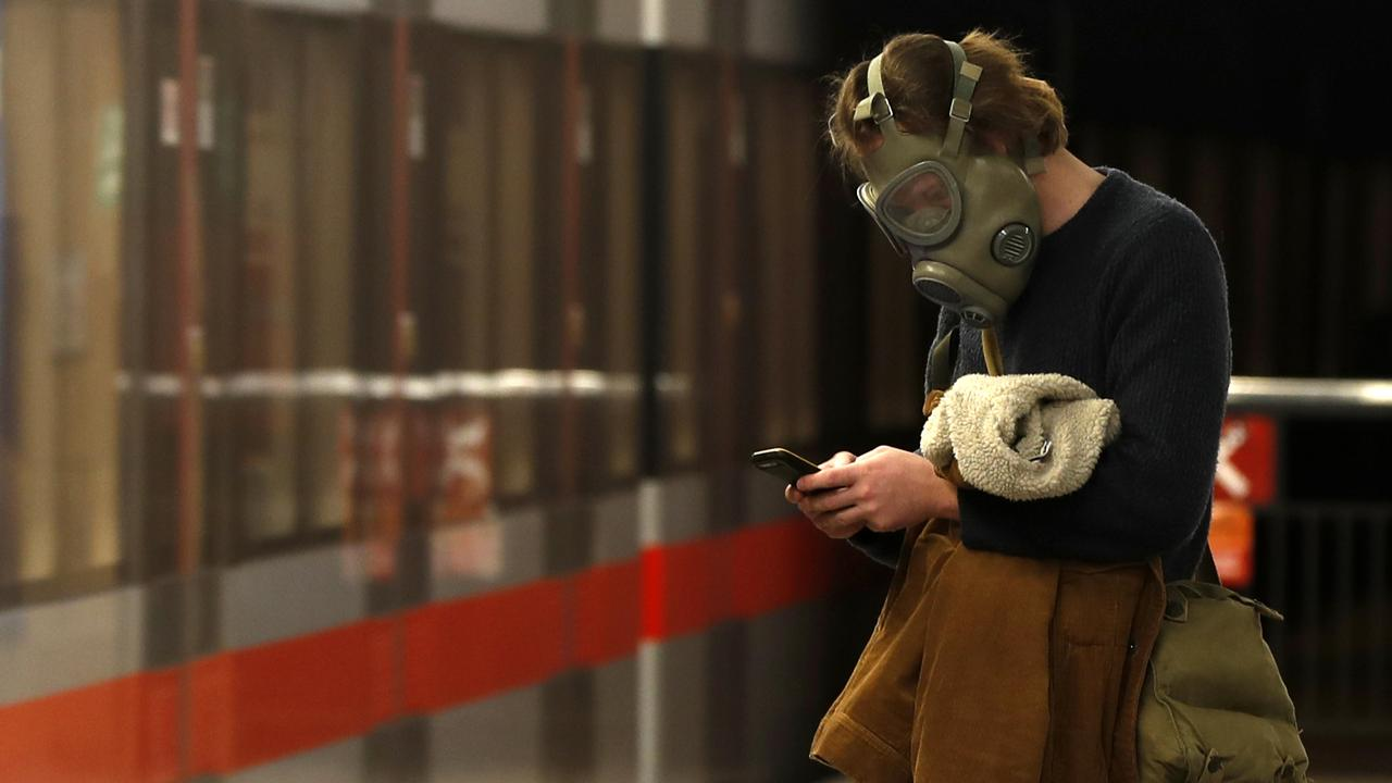 A man wearing an old military gas mask waits for the subway in Prague. Picture: Petr David Josek