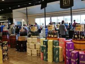 BOTTLE-O BEDLAM: Booze bulk-buying frenzy across Coast