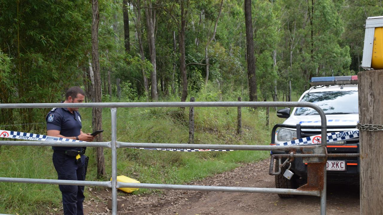 Imbil police Senior Constable Bill Greer guards the entrance to an Amamoor property.