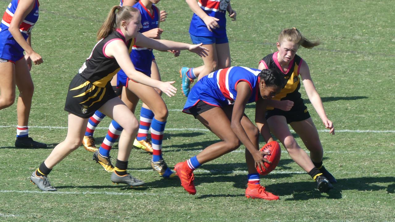 A Grafton Tigers player goes for a bump on a Bellingen Bulldog in the youth girls grand final.